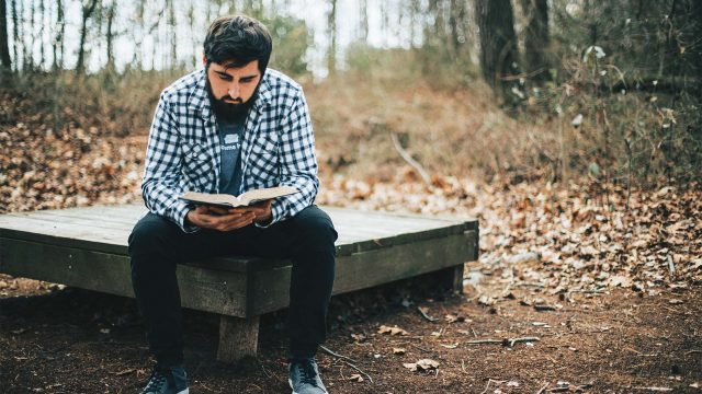 man-reading-his-bible-in-the-woods-MQUPR6B-web